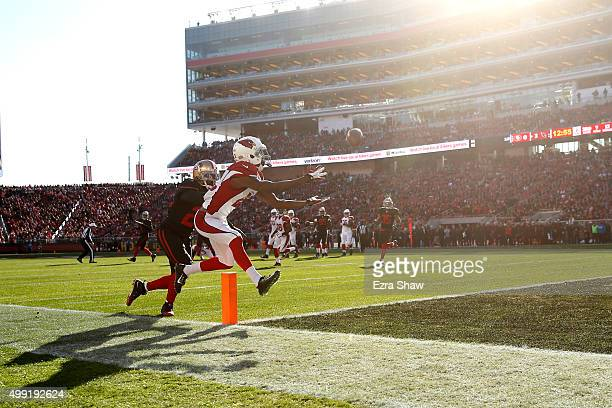 John Brown of the Arizona Cardinals catches a ball in the end zone during their NFL game against the San Francisco 49ers at Levi's Stadium on...