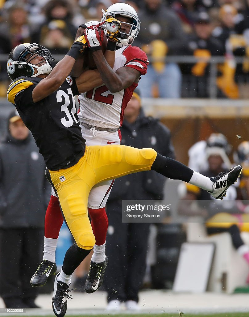 John Brown #12 of the Arizona Cardinals catches a pass over Ross Cockrell #31 of the Pittsburgh Steelers during the 1st quarter of the game at Heinz Field on October 18, 2015 in Pittsburgh, Pennsylvania.