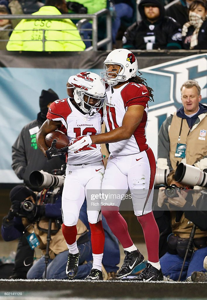 John Brown #12 of the Arizona Cardinals celebrates his touchdown catch with teammate Larry Fitzgerald #11 in the third quater against the Philadelphia Eagles at Lincoln Financial Field on December 20, 2015 in Philadelphia, Pennsylvania.