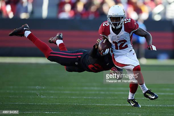 John Brown of the Arizona Cardinals makes a catch in front of Kenneth Acker of the San Francisco 49ers during their NFL game at Levi's Stadium on...
