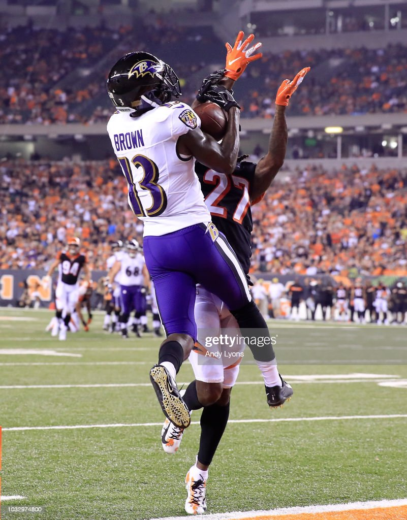 John Brown #13 of the Baltimore Ravens catches a touchdown pass while defended by Dre Kirkpatrick #27 of the Cincinnati Bengals at Paul Brown Stadium on September 13, 2018 in Cincinnati, Ohio.