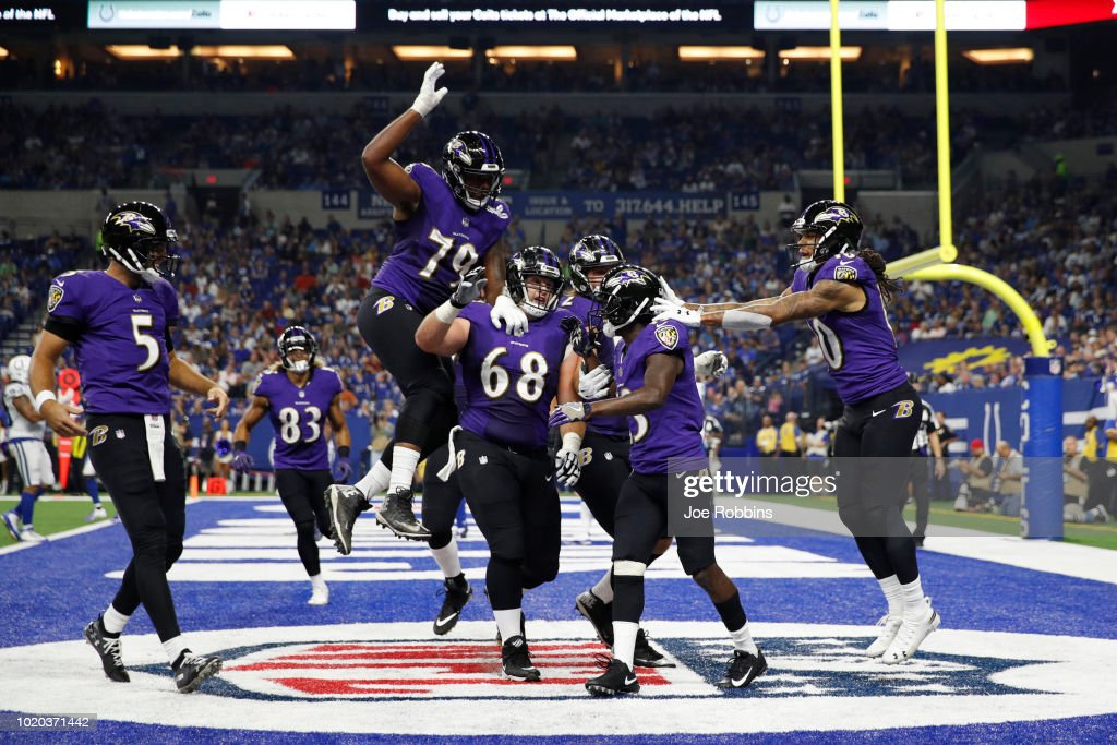 John Brown #13 of the Baltimore Ravens celebrates with teammates after a seven-yard touchdown reception against the Indianapolis Colts in the second quarter of a preseason game at Lucas Oil Stadium on August 20, 2018 in Indianapolis, Indiana.