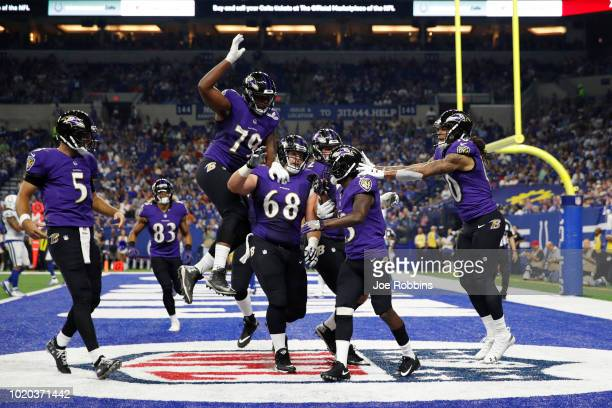 John Brown of the Baltimore Ravens celebrates with teammates after a sevenyard touchdown reception against the Indianapolis Colts in the second...