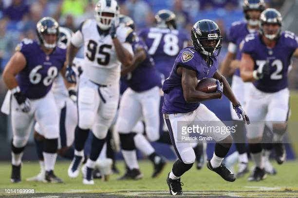 John Brown of the Baltimore Ravens rushes against the Los Angeles Rams in the first half during a preseason game at MT Bank Stadium on August 9 2018...