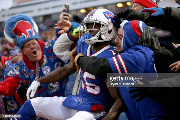 John Brown of the Buffalo Bills celebrates with fans after scoring a touchdown during the fourth quarter of an NFL game against the Denver Broncos at...