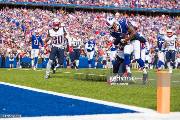John Brown of the Buffalo Bills is brought down just short of the goal line by Stephon Gilmore of the New England Patriots during the fourth quarter...