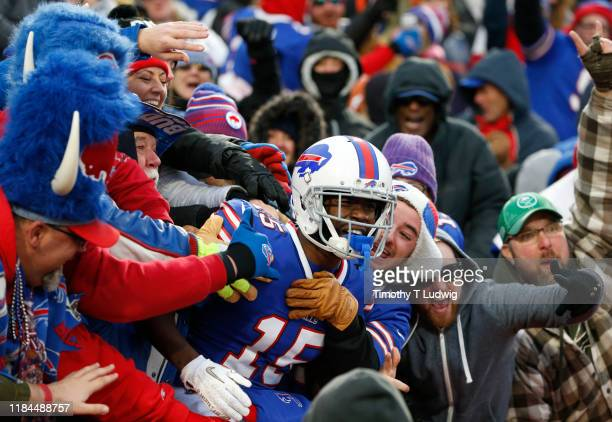 John Brown of the Buffalo Bills jumps into the crowd to celebrate his touchdown during the second half against the Denver Broncos at New Era Field on...