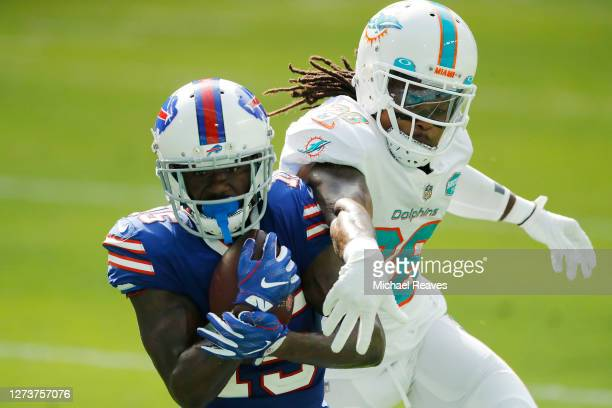 John Brown of the Buffalo Bills makes a catch over Bobby McCain of the Miami Dolphins for a touchdown during the fourth quarter at Hard Rock Stadium...