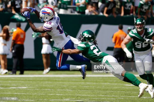 John Brown of the Buffalo Bills makes a catch over Darryl Roberts of the New York Jets during the first quarter at MetLife Stadium on September 08,...