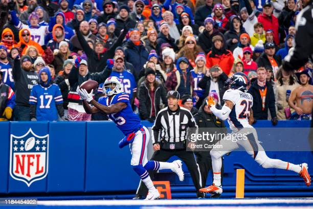 John Brown of the Buffalo Bills makes a touchdown pass reception during the fourth quarter against the Denver Broncos at New Era Field on November...