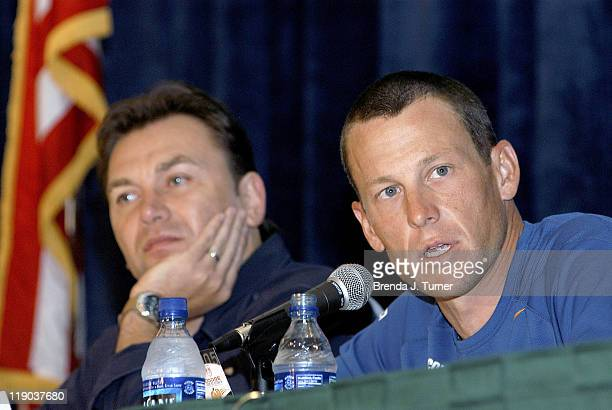 John Bruyneel looks on as Lance Armstrong announces retirement from professional cycling after July 24 2005 during a Tour de Georgia Press Conference...