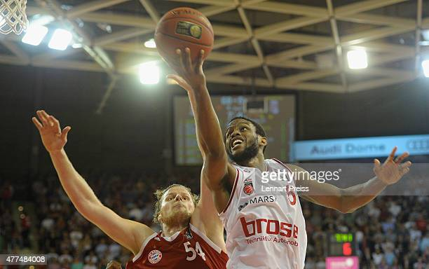 John Bryant of FC Bayern Muenchen tries to block Darius Miller of the Brose Baskets Bamberg during Game Four of the 2015 BBL Finals at AudiDome on...