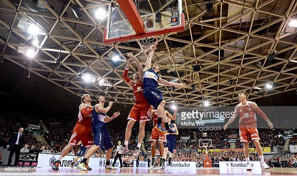 John Bryant of Muenchen and Chris Kramer of Oldenburg compete for the ball during the match between FC Bayern Muenchen and EWE Baskets Oldenburg at...