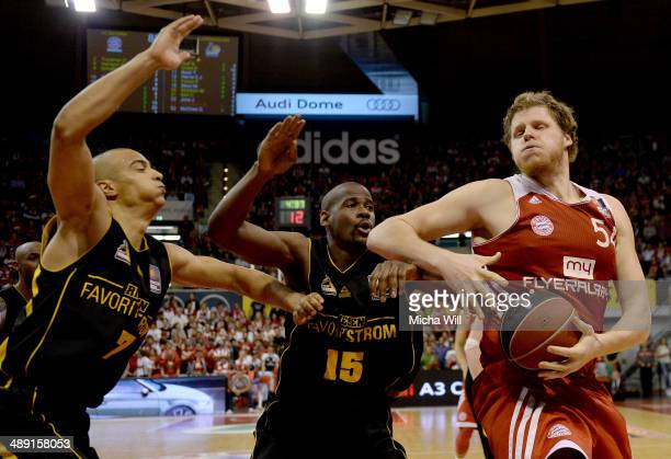 John Bryant of Muenchen competes with Shawn Huff and Patrick Flomo of Ludwigsburg during game one of the 2014 Beko BBL Playoffs semifinals between FC...
