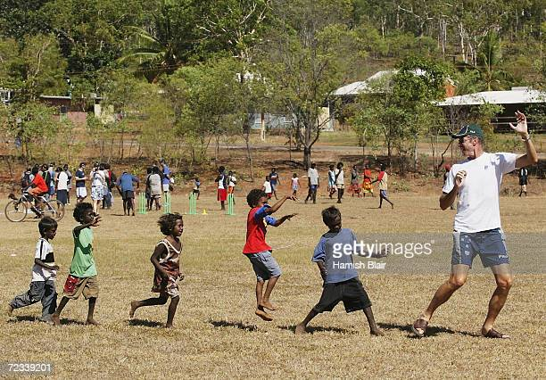 John Buchanan of Australia leads some locals through a drill on July 22 2003 during a team visit to an Aboriginal settlement on Melville Island off...