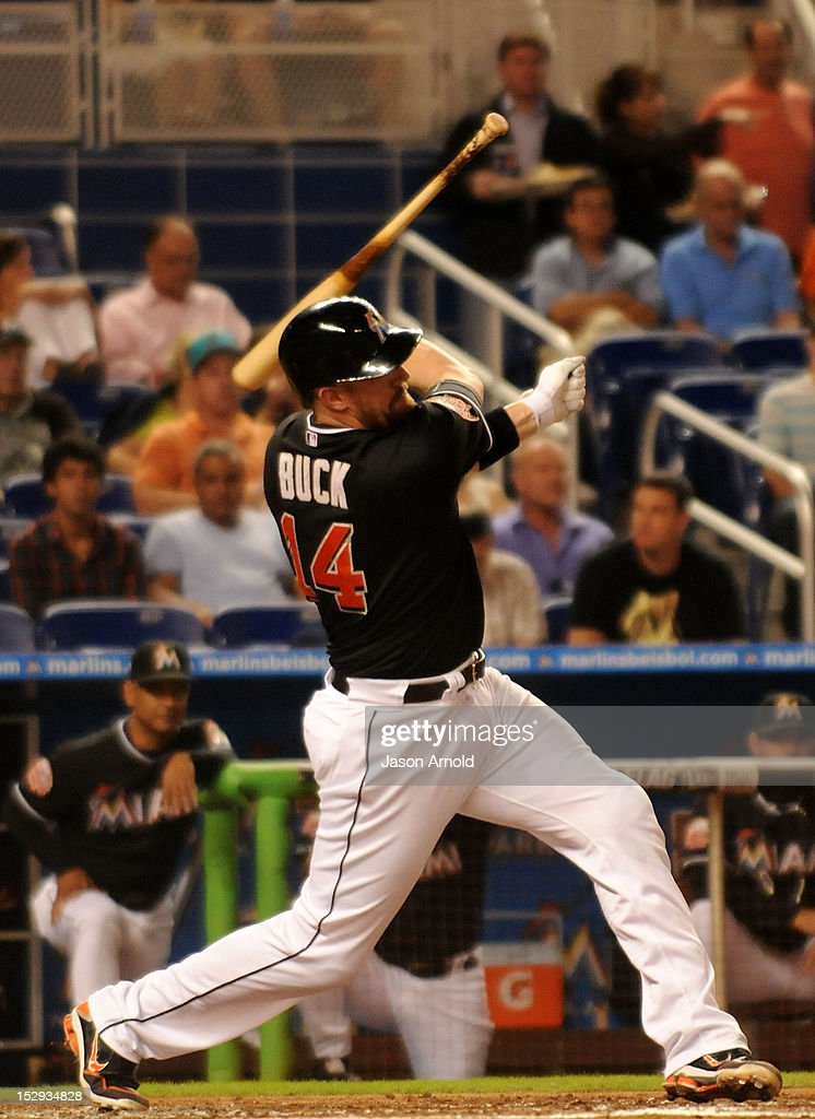 John Buck #14 of the Miami Marlinsloses control of his bat against the Philadelphia Phillies at Marlins Park on September 28, 2012 in Miami, Florida.