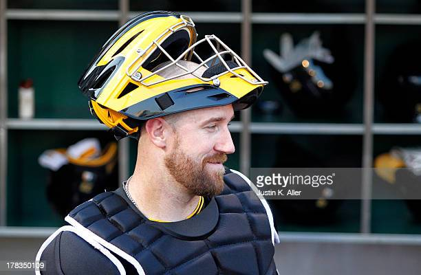John Buck of the Pittsburgh Pirates looks on in his first start as a Pittsburgh Pirates against the Milwaukee Brewers during the game on August 29...