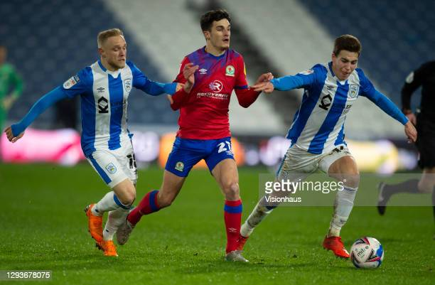 John Buckley of Blackburn Rovers with Alex Pritchard and Carel Eiting of Huddersfield Town in action during the Sky Bet Championship match between...