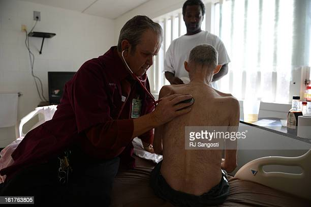 John Buglewicz MD monitors inmate Robert Bryan's condition by checking his heart rate and breathing November 08 2012 Since Bryan signed prison...