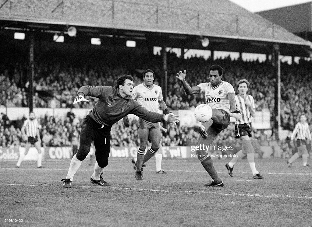 John Burridge of Sheffield United palms the ball away to deny Luther Blissett of Watford during the FA Cup 3rd round match at Vicarage Road in Watford on the 5th January, 1985. Watford won 5-0.