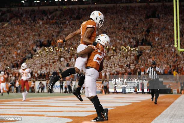 John Burt of the Texas Longhorns celebrates with Keaontay Ingram after a second quarter touchdown against the Iowa State Cyclones at Darrell K...