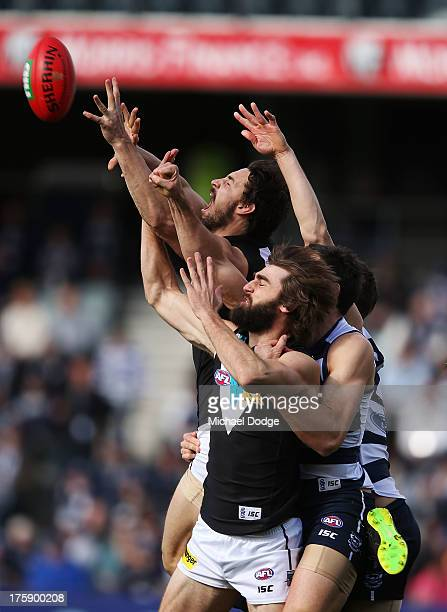 John Butcher of Port Adelaide marks the ball during the round 20 AFL match between the Geelong Cats and Port Adelaide at Simonds Stadium on August 10...