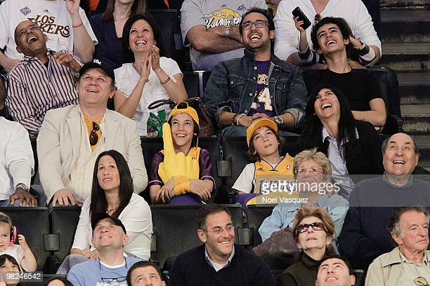John C Reilly and his wife Alison Dickey attend a game between the San Antonio Spurs and the Los Angeles Lakers at Staples Center on April 4 2010 in...