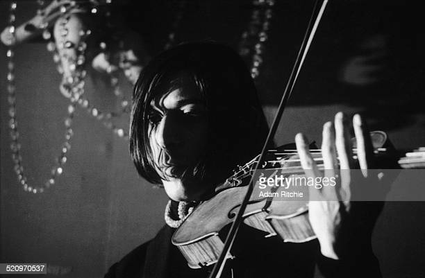 John Cale of the Velvet Underground performs on stage at the New York Society for Clinical Psychiatry annual dinner, The Delmonico Hotel, New York,...