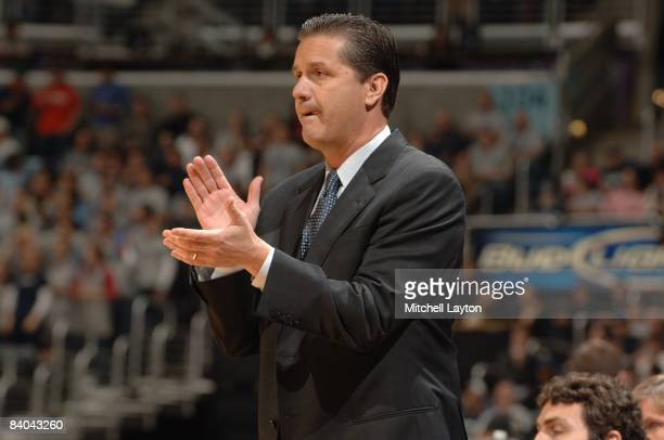 John Calipari, head coach of the Memphis State Tigers, claps during a college basketball game against the Georgetown Hoyas on December 13, 2008 at...