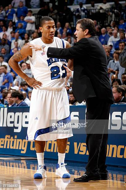 John Calipari head coach of the Memphis Tigers gives instructions to Derrick Rose of the Memphis Tigers in a game against the Richmond Spiders during...
