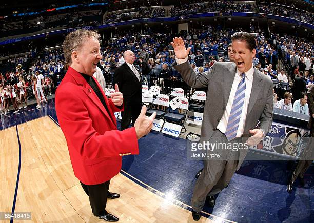 John Calipari head coach of the Memphis Tigers shares a laugh with Tom Penders head coach of the Houston Cougars during the Semifinals of the...