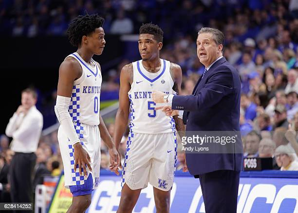 John Calipari the head coach of the Kentucky Wildcats gives instructions to De'Aaron Fox and Malik Monk during the game against the Valparaiso...