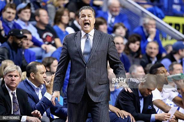 John Calipari the head coach of the Kentucky Wildcats gives instructions to his team during the game against the Missouri Tigers at Rupp Arena on...
