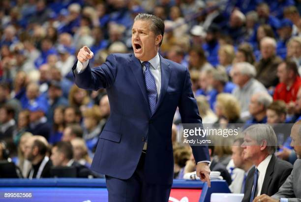 John Calipari the head coach of the Kentucky Wildcats gives instructions to his team against the Louisville Cardinals during the game at Rupp Arena...