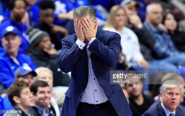John Calipari the head coach of the Kentucky Wildcats reacts to a mistake by his team in the first half of the 67-64 loss to the Evansville Aces at...