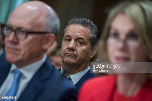 John Calipari University of Kentucky men's basketball coach sits behind Kelly Knight Craft nominee to be ambassador to Canada and Robert Wood Johnson...