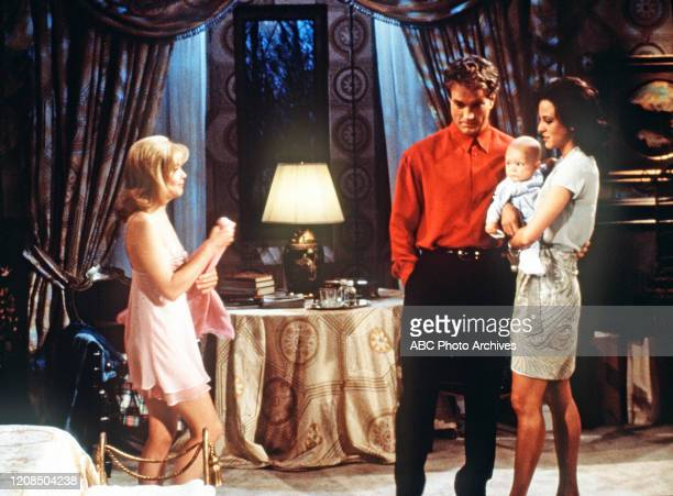 John Callahan baby Madeline and Eva LaRue in a scene airing the week of June 23 1997 on ABC Daytime's All My Children All My Children airs...