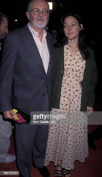 John Calley and Meg Tilly attend the premiere of 'Anaconda' on April 7 1997 at Mann Village Theater in Westwood California