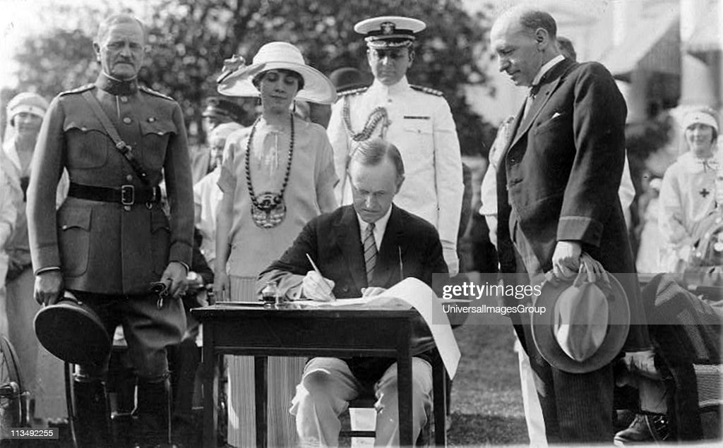 John Calvin Coolidge (1872-1933) 30th President of the USA 1923-1929 (Republican), signing Veterans' Bill and other bills on the White House Lawn, 1924. General of the Armies John Joseph Pershing (1860-1948) looks on. America ... : News Photo