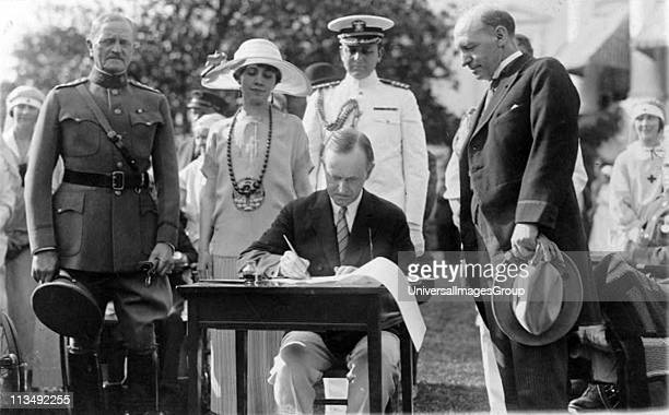 John Calvin Coolidge 30th President of the USA 19231929 signing Veterans' Bill and other bills on the White House Lawn 1924 General of the Armies...