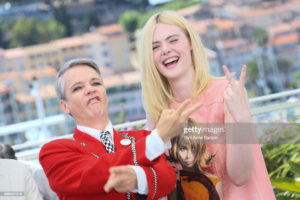 John Cameron and Elle Fanning attend the 'How To Talk To Girls At Parties' Photocall during the 70th annual Cannes Film Festival at Palais des Festivals on May 21, 2017 in Cannes, France.