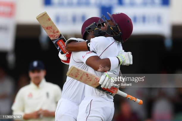 John Campbell of the West Indies embraces Kraigg Brathwaite as he hits the winning runs to seal victory on Day Three of the 2nd Test match between...