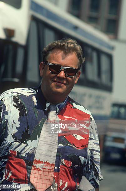 John Candy in a graphic red white and blue shirt and tie circa 1970 New York