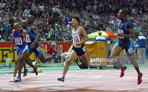 John Capel of the USA crosses the the line to win gold from Darvis Patton in second and Shingo Suetsugu of Japan in third place in the men's 200m...