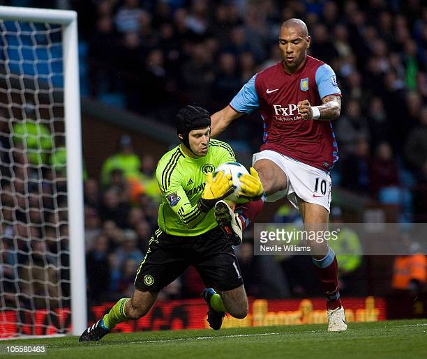 John Carew of Aston Villa and Petr Cech of Chelsea in action during the Barclays Premier League match between Aston Villa and Chelsea at Villa Park...