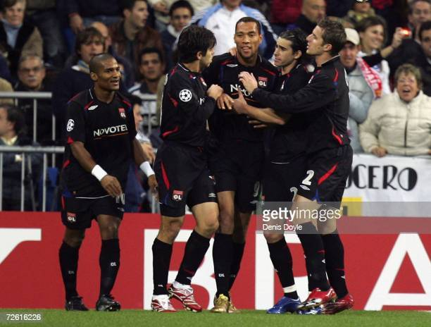John Carew of Lyon celebrates with teammates after scoring a goal against Real Madrid during the UEFA Champions League Group E match between Real...