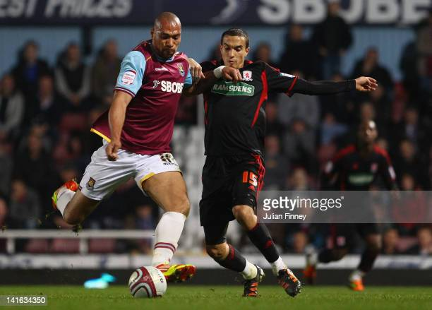 John Carew of West Ham goes to shoot at goal as Seb Hines of Middlesbrough tries to block during the npower Championship match between West Ham...