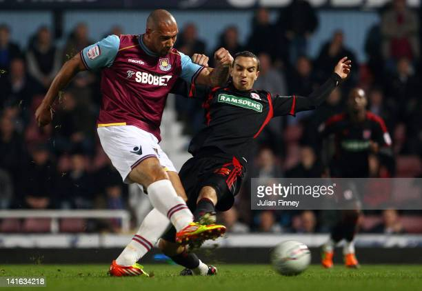John Carew of West Ham shoots at goal as Seb Hines of Middlesbrough tries to block during the npower Championship match between West Ham United and...