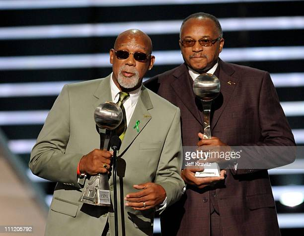 John Carlos and Tommie Smith accept the Arthur Ashe Award for Courage as they were given the award for their blackgloved fist salute at the 1968...