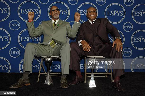 John Carlos and Tommie Smith pose with NBA player Steve Nash as Carlos and Smith accept the Arthur Ashe Award with for Courage as they were given the...